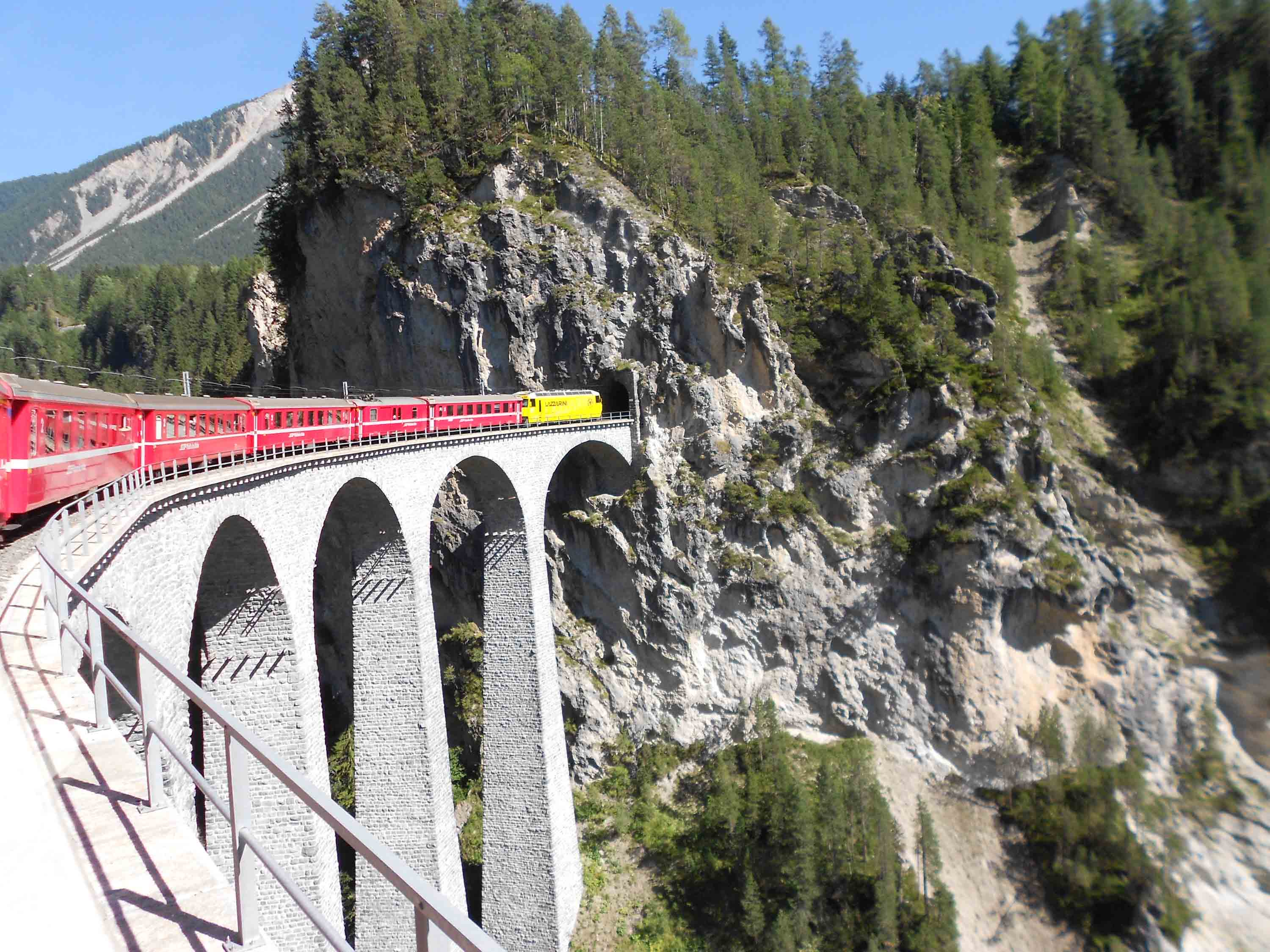 Passing over the Landwasser Aquaduct into the tunnel cut into the rock face.