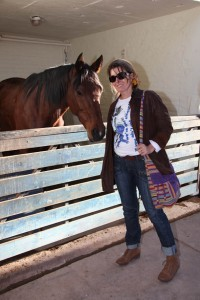 The writer making friends with one of the beautiful horses on the property