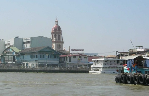 The Church of Santa Cruz in the historic Portuguese enclave on the West bank of the Chao Praya presides over the chaos of the working river.
