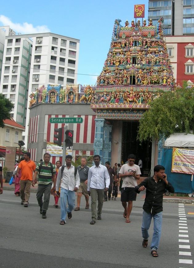 After prayer, a call: Devotees take to their phones after prayer at Sree Veeramakaliamman temple in Serangoon Road, one of the key houses of worship in the city state.