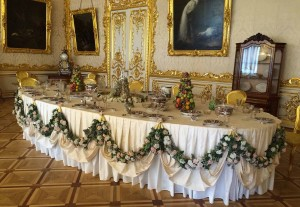 Set table in the dining room of St Catherine's Palace. Note the exquisite floor detail.