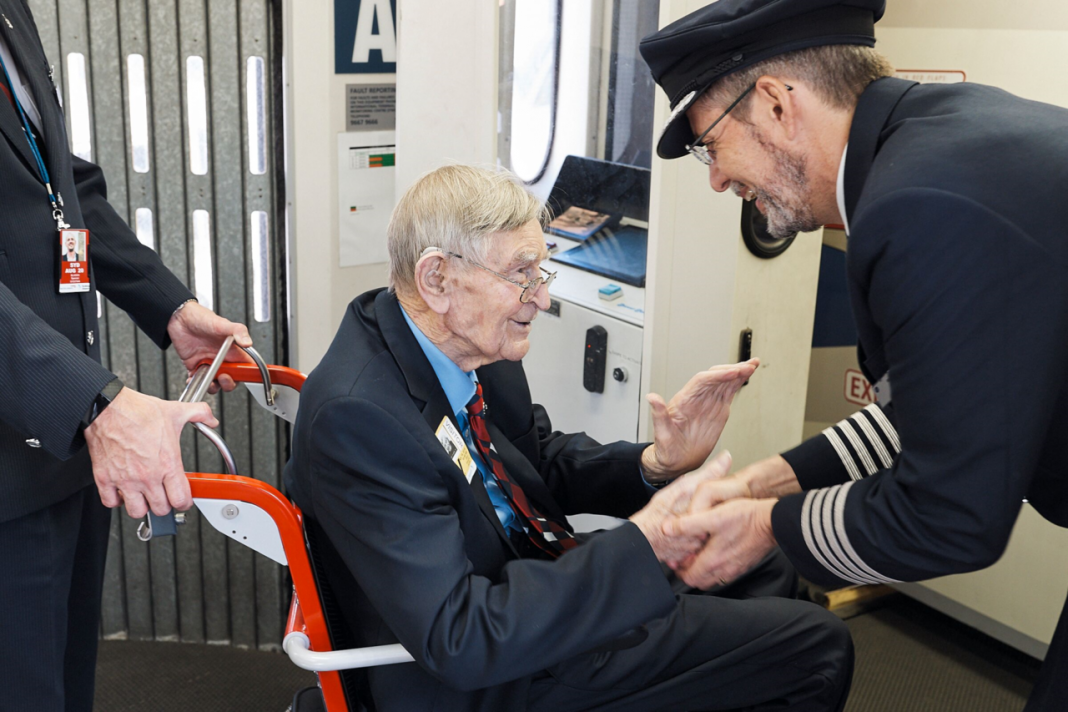 Former RAF pilot Frank Dell (96) from Bupa St. Ives care home in Sydney ventures onto the flight deck of a British Airways Boeing 777 at Sydney airport.