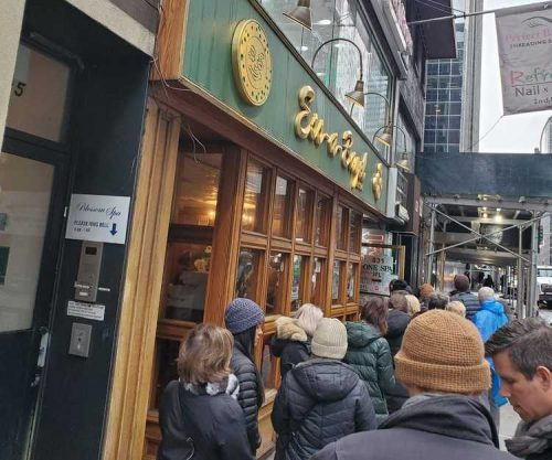 People stand in line for hours, for a taste of New York's famous Ess-a-Bagel